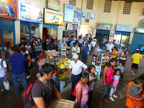 Photo: Crowded bus terminal in Tena