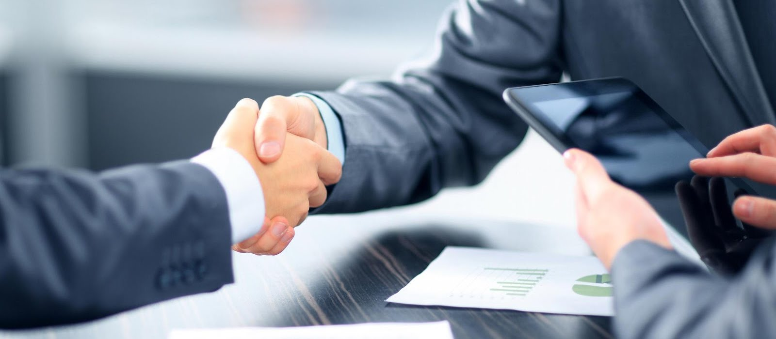 Shaking hands after agreeing business in Houghton Regis