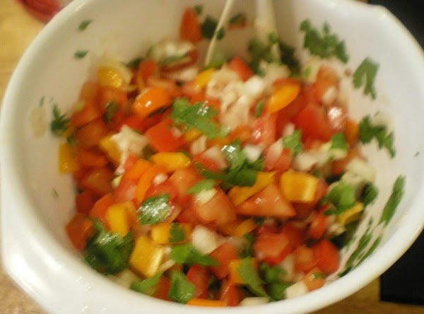 Add all veggies, oil, and lime juice in a medium bowl.  Stir to...