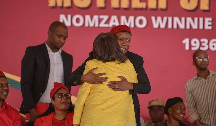 EFF leader Julius Malema embraces Cape Town Mayor Patricia de Lille at the EFF's memorial service for Winnie Madikizela-Mandela.