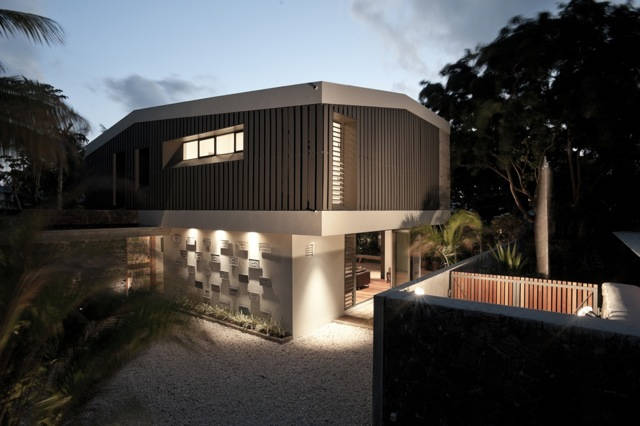 Photo: The concept for the project took on the volumes from the existing typography of the detached villas in the vicinity and extrapolated these forms as shells. More in AD: http://archdai.ly/LfI1yc