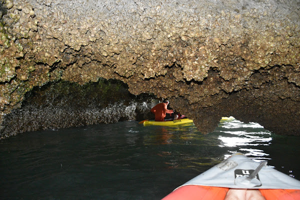 Paddle by kayak into caves and lagoons on Phanak Island