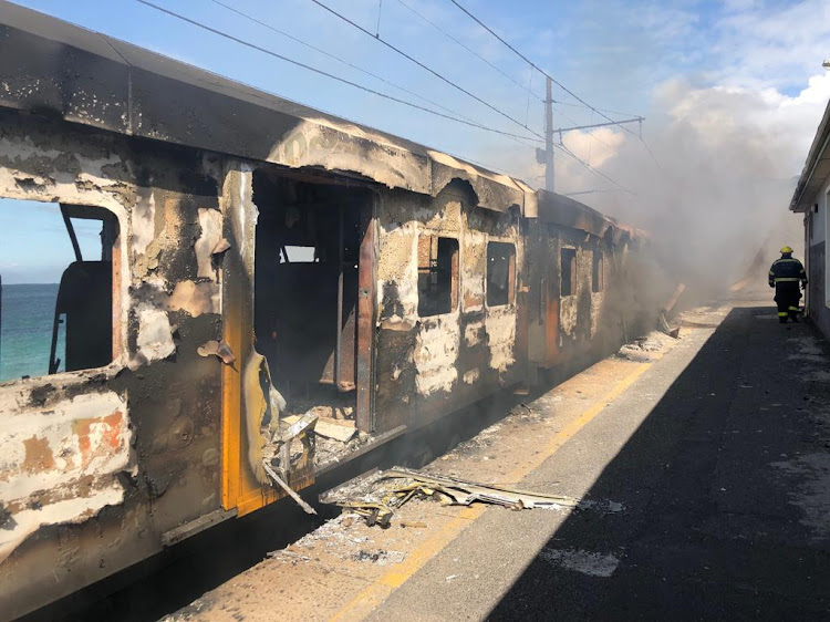 Three train carriages were damaged by fire at Glencairn train station on Monday.