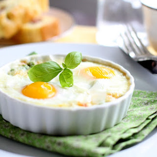Pea, Basil, and Parmesan Baked Eggs with Smoked Cheddar and Sausage Brioche