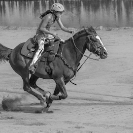 Finishing her run by Joe Saladino - Black & White Sports ( horse, barrel race, monochrome, rider, sport )