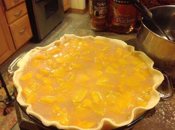 Line deep dish pie plate with first crust, then ladle in peach pie filling...
