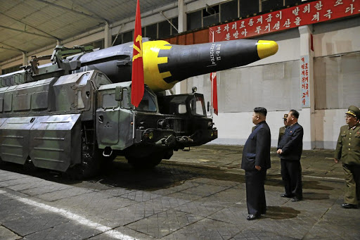 North Korean leader Kim Jong-un inspects the long-range strategic ballistic rocket Hwasong-12 (Mars-12) in this undated photo released by North Korea's Korean Central News Agency. Picture: KCNA VIA REUTERS