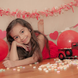 Sweet Heart by Chris Cavallo - Babies & Children Child Portraits ( valentine's, hearts, girl, red, toy, maine, confetti, candy, truck, pink, balloons, portrait,  )