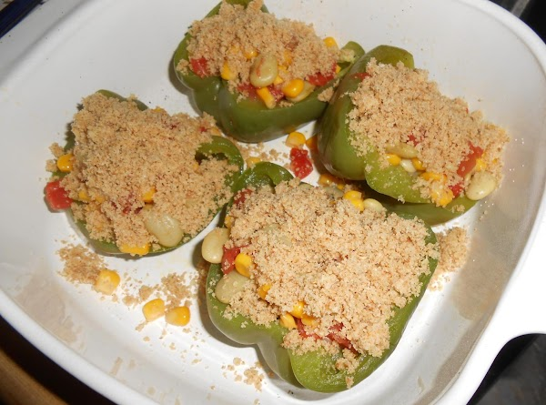 Combine bread crumbs with melted butter; sprinkle over stuffed peppers. Bake at 350 degrees...