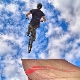 by Marco Bertamé - Sports & Fitness Other Sports ( clouds, wood, speed, dow, stunt, bicycle, jump, ramp, red, sky, blue, air, brown, high )