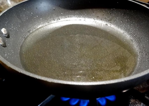 Pour olive oil just to cover the bottom of a small skillet and heat...