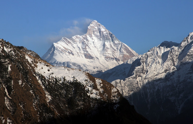 FILE IMAGE: Snow-covered Nanda Devi mountain is seen from Auli town, in the northern Himalayan state of Uttarakhand, India