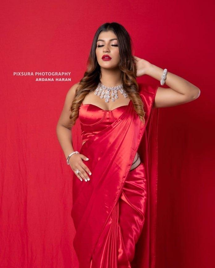 Yashika Aannand hot stills in red saree Navel Queens