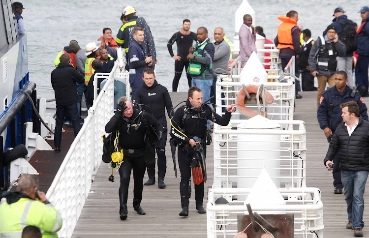 National Sea Rescue Institute rescue divers used life rafts to transfer passengers' all wearing lifejackets' from Thandi to Madiba 1' which went to the rescue.