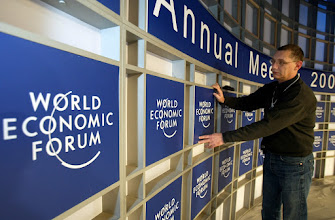 Photo: NEW YORK, 29JAN02 - Alain Duchaussoy of 'Public Events' is fixing a sign with the logo of the World Economic Forum on the stage at the plenary hall of the Waldorf-Astoria Hotel in New York City, where the Annual Meeting 2002 will take place from Januar 31 to Februar 4, 2002. 