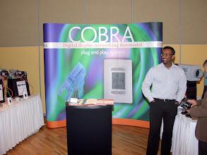 "Photo: Imtee Baksh of Regulvar shows off their ""Cobra"" networking system"