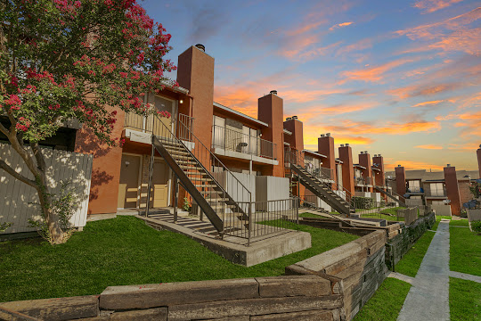 Chula Vista apartment building with orange stucco exterior at dusk