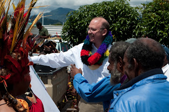 Photo: Rev. John Mehl being greeted upon arrival in Papua New Guiena.