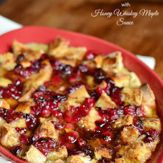 Cranberry Bread Pudding with Honey Whiskey Maple Sauce.