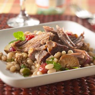 Slow-Smoked Berkshire Pork Butt with Michigan Cherry and White Bean Salad.