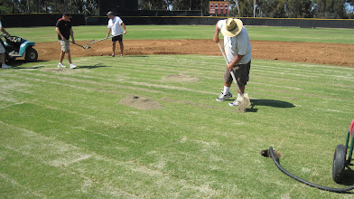 Photo: Adding a 2nd lift of top-dressing sand to really get a smooth finish on it and fill in seams.