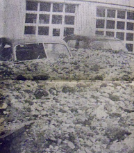 Photo: Cars outside a service station in Winsted are buried in rubble up to their roofs.