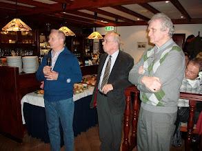 Photo: De voorzitter Rien Wildhagen (l) kondigt de opening van het buffet aan bijgestaan door penningmeester Rinus van Oosterhout (m) en secretaris Ad Buijs (r).