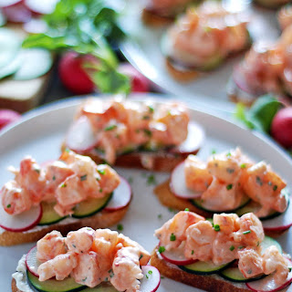 Shrimp Toasts with Cucumber and Radishes.