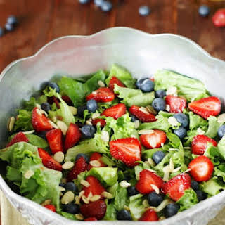 Strawberry, Blueberry & Greens Salad with Honey Vinaigrette.