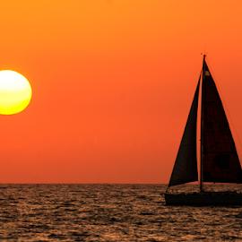 Sailing  at sunset by Yuval Shlomo - Transportation Boats ( sunrise, sunrises, ocean, sunset, boats, sailing, sun, boat, sea )
