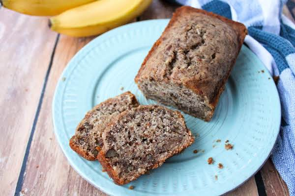 Slices Of Zucchini Banana Bread On A Plate.