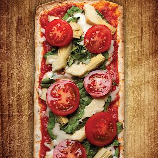 Thin Crust Tomato, Artichoke and Spinach Flatbread Pizza.