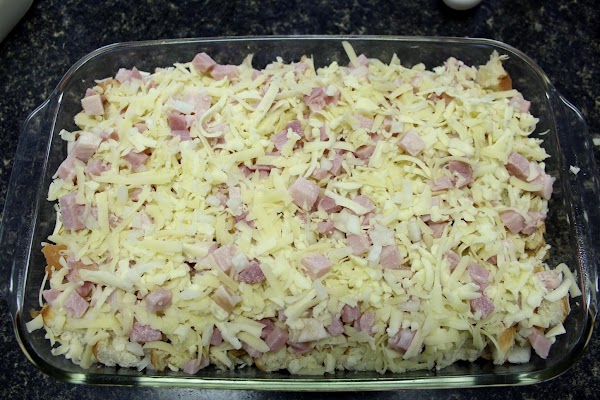 Evenly distribute chopped ham, minced shallots, baby Swiss and Monterey Jack over bread; set...