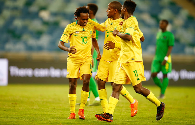 Percy Tau of SA celebrates his goal with teammates Lebo Manyama and Themba Zwane during the Afcon qualifier between SA and Sao Tome and Príncipe at the Moses Mabhida Stadium on November 13 2020 in Durban. Picture: BACKPAGEPIX/STEVE HAAG