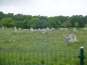 Photo: Local lore (Brittany has its own versions of the Arthurian legend) claims that the menhirs stand in such perfectly straight lines because they are a Roman legion turned to stone by Merlin.