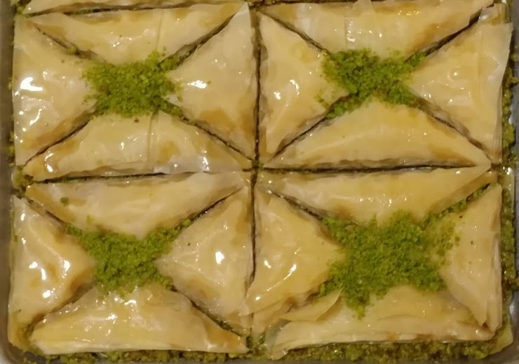 Baklava is made with rich amount of Pistachio that has strong flavor, light amount of sugar syrup (with no honey) and Clarified butter.  (Vegetarian)