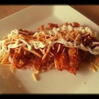 Easy Dorito Crusted Taco Chicken over Mexican Rice.