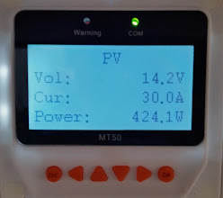 Photo: [Device replaced with a Victron unit now] At midday the solar panels are pushing out 14.2V at 30 Amps (maximum that the charge controller is rated for) which equates  to 424 Watts of power.