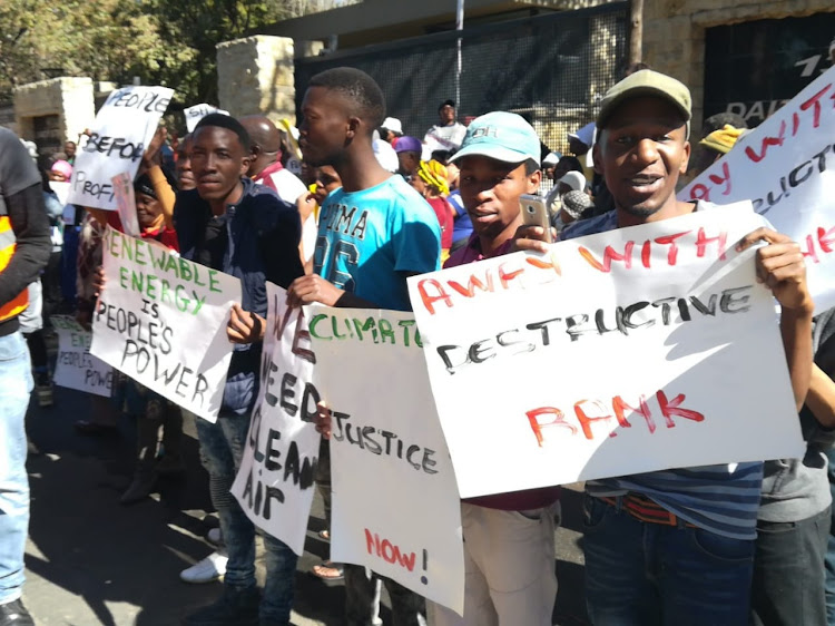 Earthlife Africa representatives protesting outside the New Development Bank offices in Sandton calling for the development of renewable energy resources and the prevention of climate change on July 25 2018
