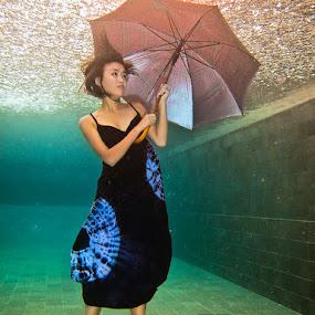 It's raining outside by Hartono Hosea - People Fashion