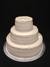 Photo: Champagne smooth wedding cake w/silver diamond wrap trim.
