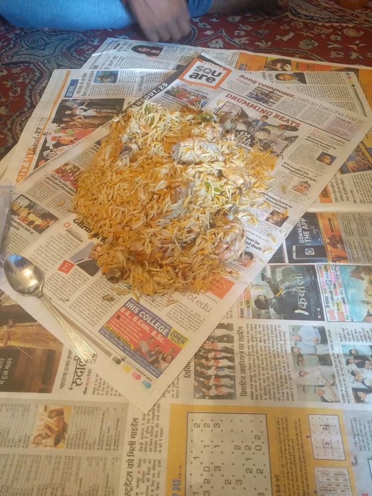 Eating chicken biryani on the floor
