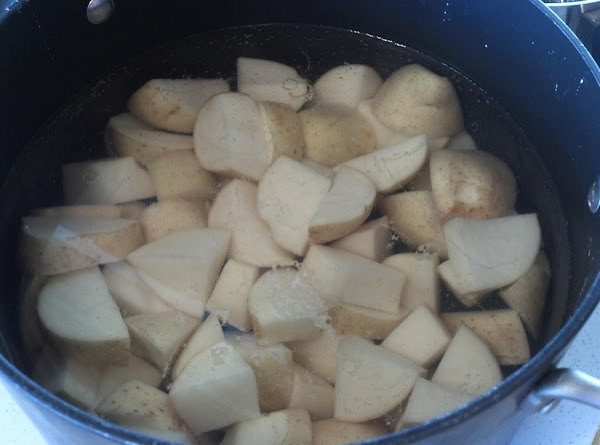 Wash and remove any blemishes from potatoes, cut into bite size cubes, boil until...