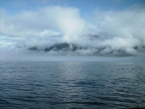 Photo: Fog and clouds obscure an un-named mountain peak. Windham Bay in Stephens Passage.