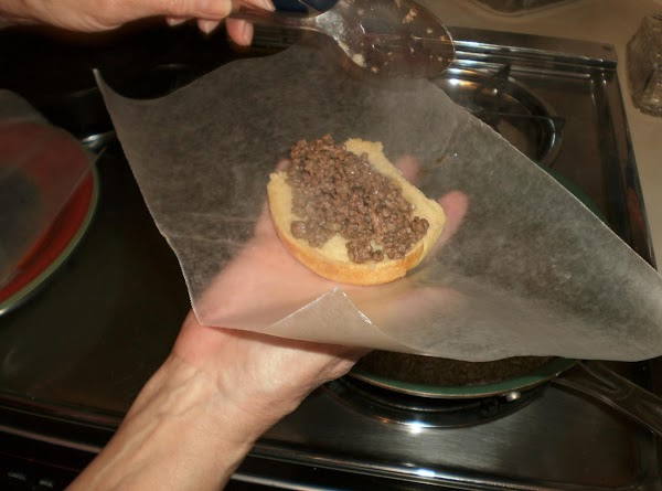 Using a slotted spoon scoop out of skillet onto a bun and wrap in...