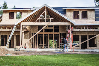 """Photo: This side took about a day too long because we couldn't use the forklift.  Everything was difficult, from getting that 5 1/2x15x24' glulam in place, to setting the ridge. 24"""" overhangs on the gable were tough too."""