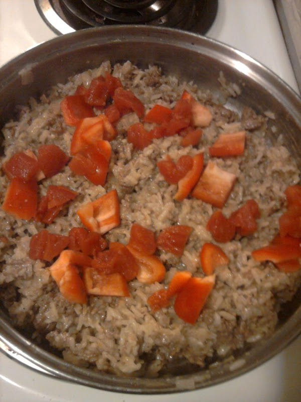 Add chopped peppers, tomatoes, and any other vegetable to the top of the rice...