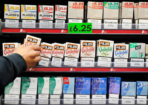 A man arranges cigarettes in a shop in central London, the UK. Picture: EPA/FACUNDO ARRIZABALAGA