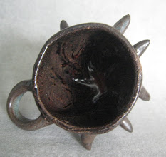"""Photo: tiny defender series punch cup's insides 2.75"""" tall"""