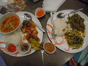 Photo: Curry, chicken with cashews, satay, rice; larb, vegetable, rice; sauces